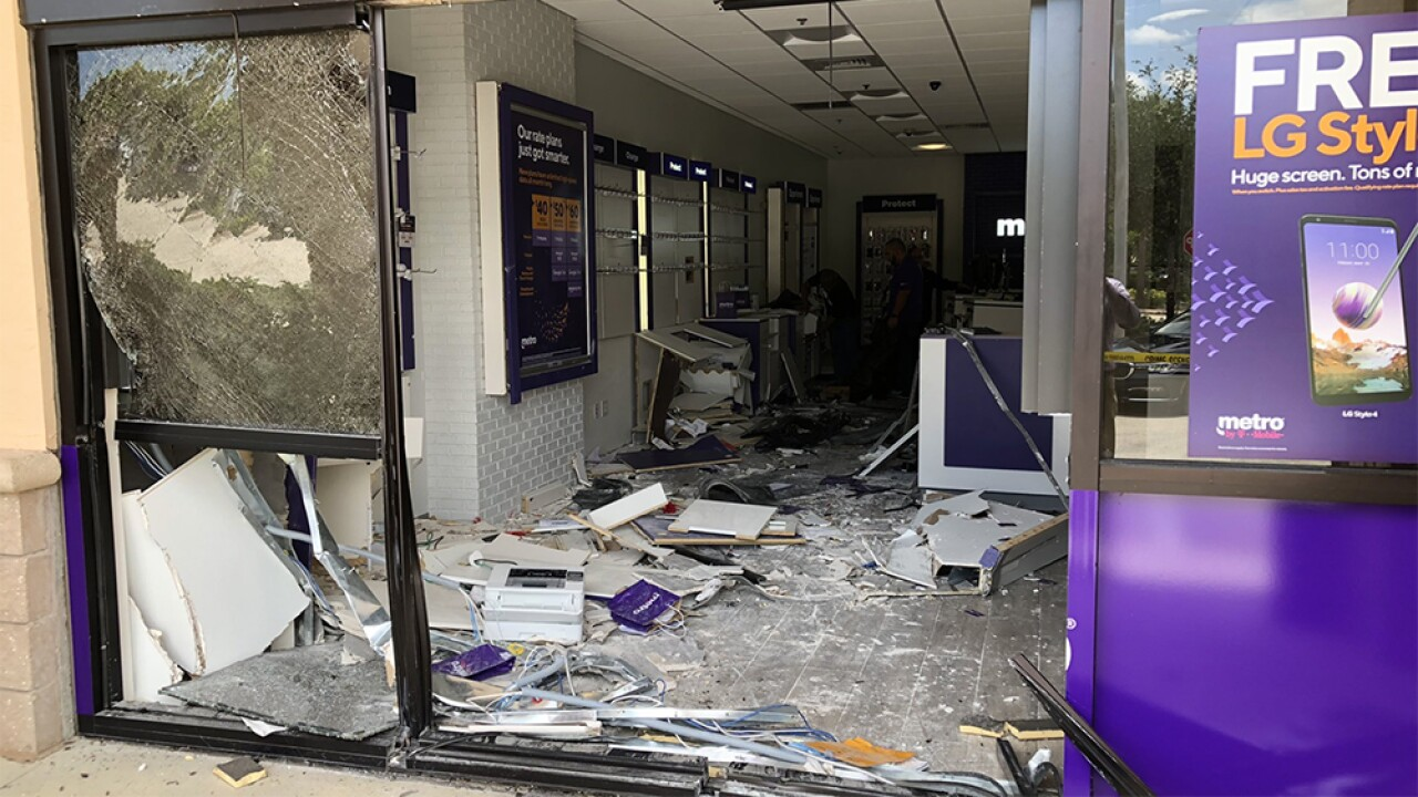 Vehicle crashes into MetroPCS store in Wellington, person