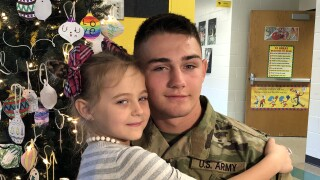 Lily Mae Borcher hugs her older brother, Pfc. Christopher Borcher