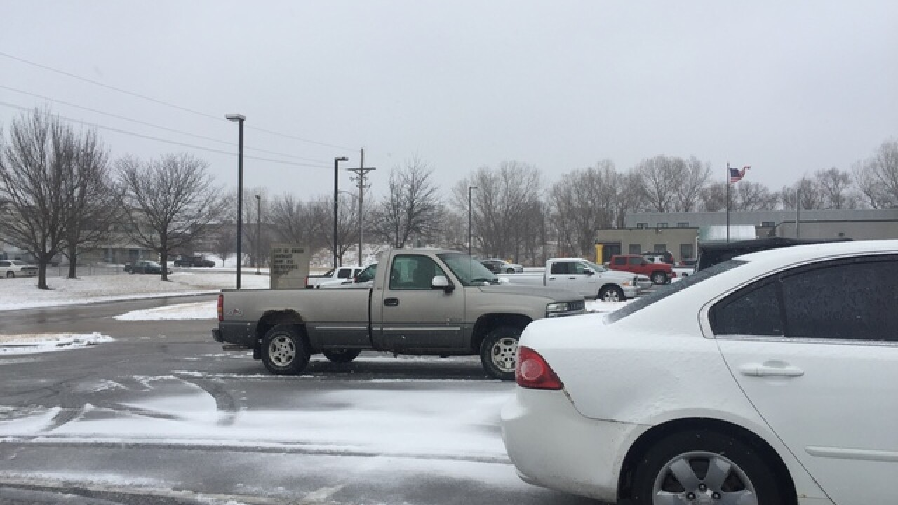 Wet snow has Omaha road crews working long hours