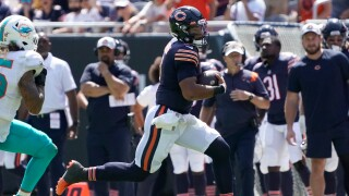 Chicago Bears quarterback Justin Fields runs for a touchdown against the Miami Dolphins on Aug. 14, 2021.jpg