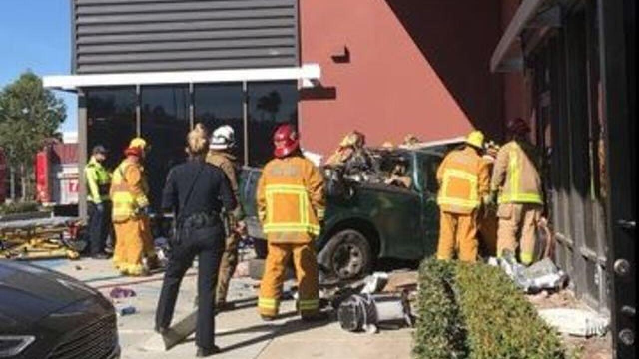Car crashes into building in El Cajon