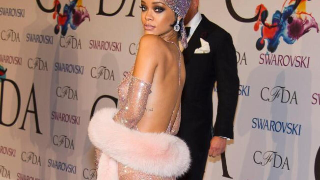 Rihanna bares almost all in sheer, sparkly dress