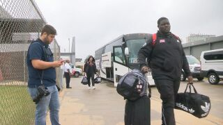UL football team leaving.jpg