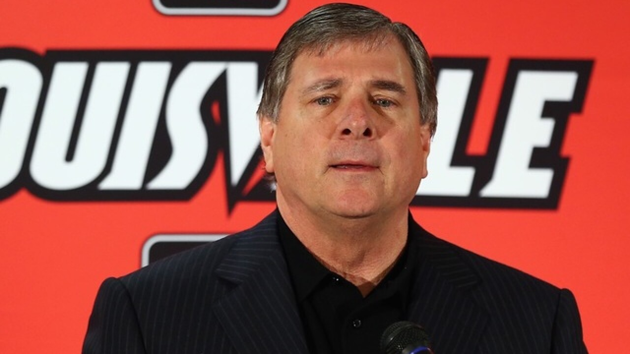 Louisville settles for $4.5M with ex-AD Jurich over firing