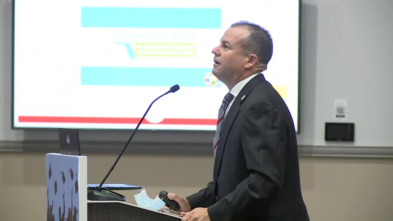 Clint Sperber, health officer and administrator for the Florida Department of Health in St. Lucie County, talks to school board