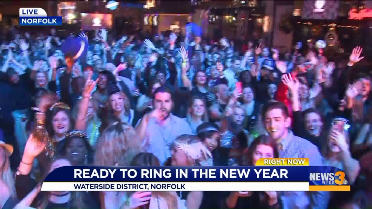 Revelers welcome 2020 with music, fun and resolutions at Waterside District's annual New Year's event