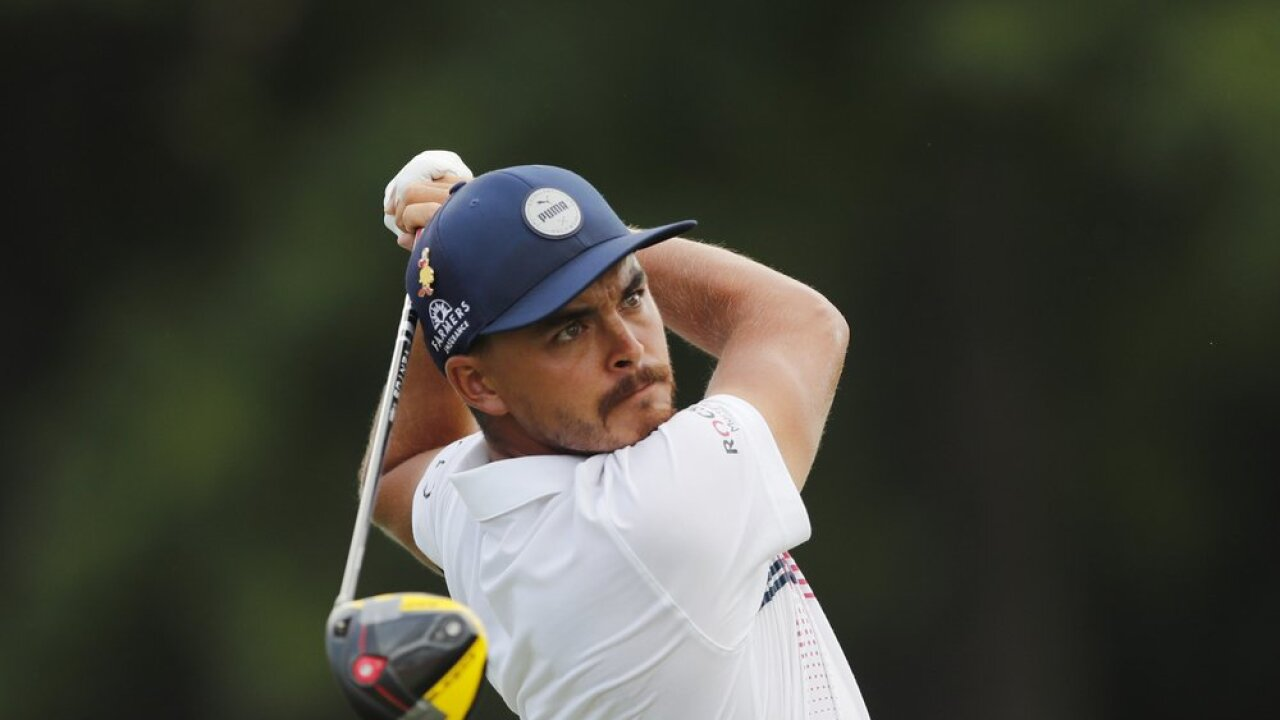Rickie Fowler swings during the second round of the Rocket Mortgage Classic golf tournament, Friday, July 3, 2020, at the Detroit Golf Club in Detroit. (AP Photo/Carlos Osorio)
