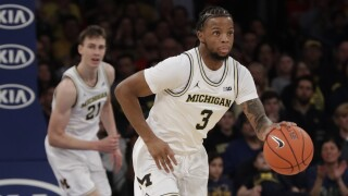 Michigan hand Rutgers first home loss 60-52