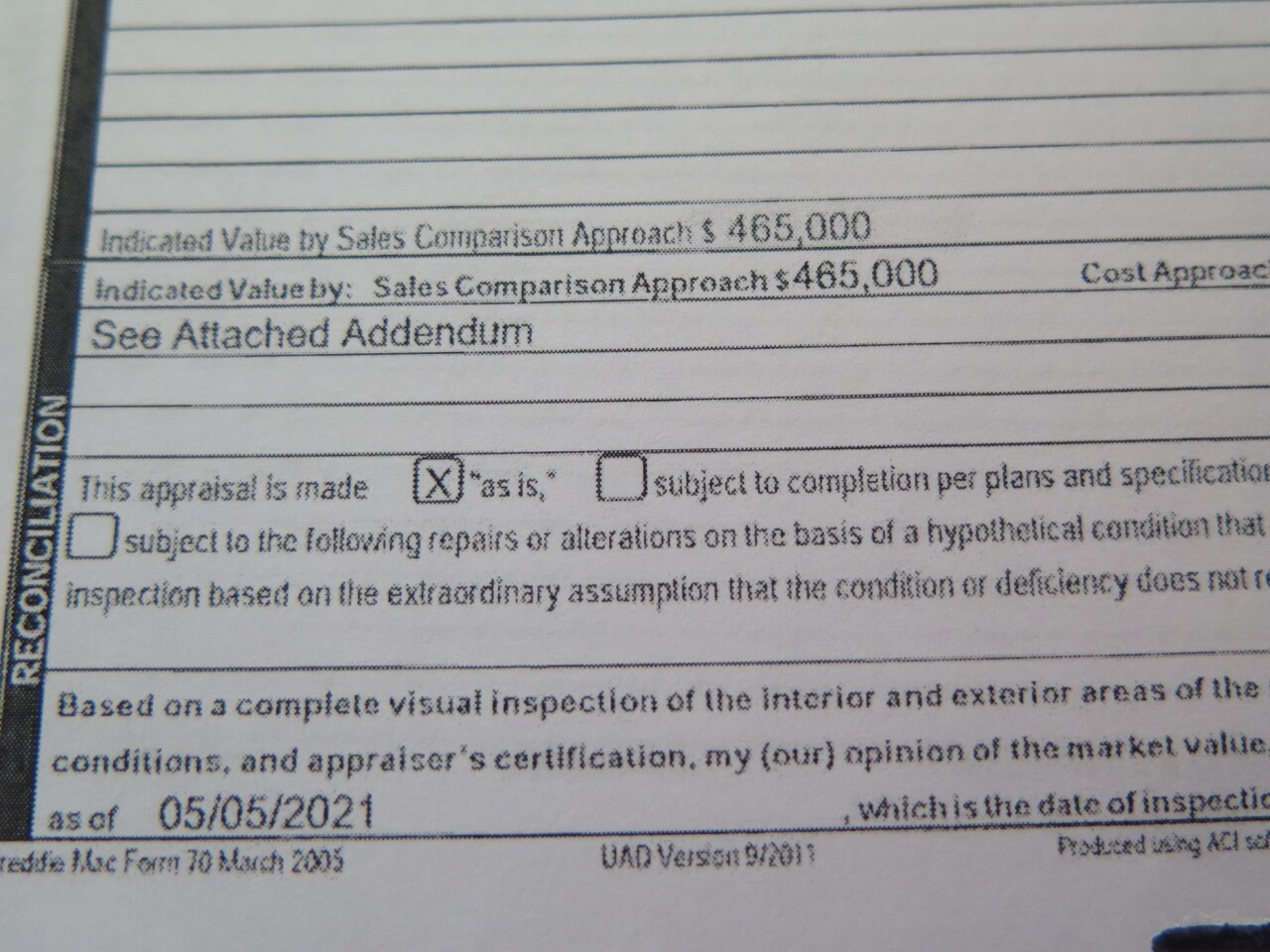 This page from a May 5, 2021, appraisal of the Parkers' Loveland home shows a value of $465,000.