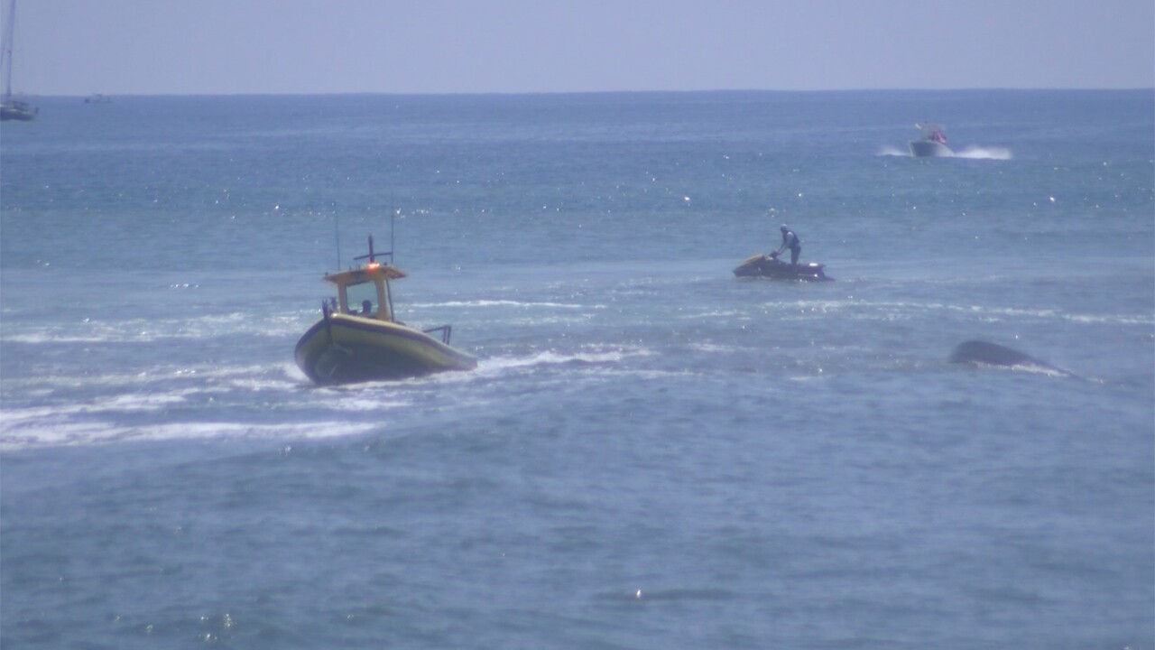 Three people were rescued Sunday afternoon by the Palm Beach County Sheriff's Office Marine Unit after their boat capsized at the Boynton Beach Inlet.