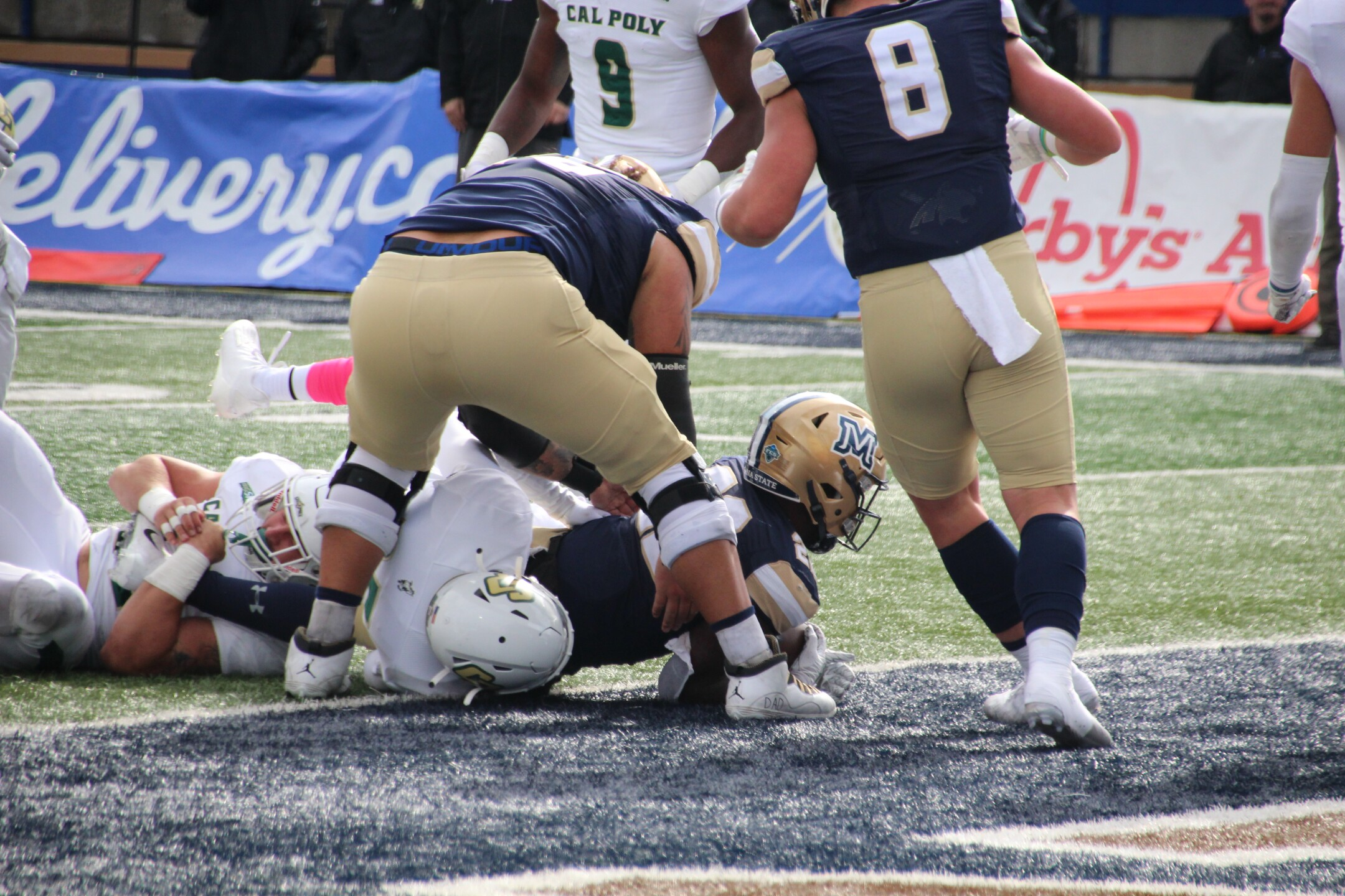 Isaiah Ifanse leans into the end zone for a rushing touchdown