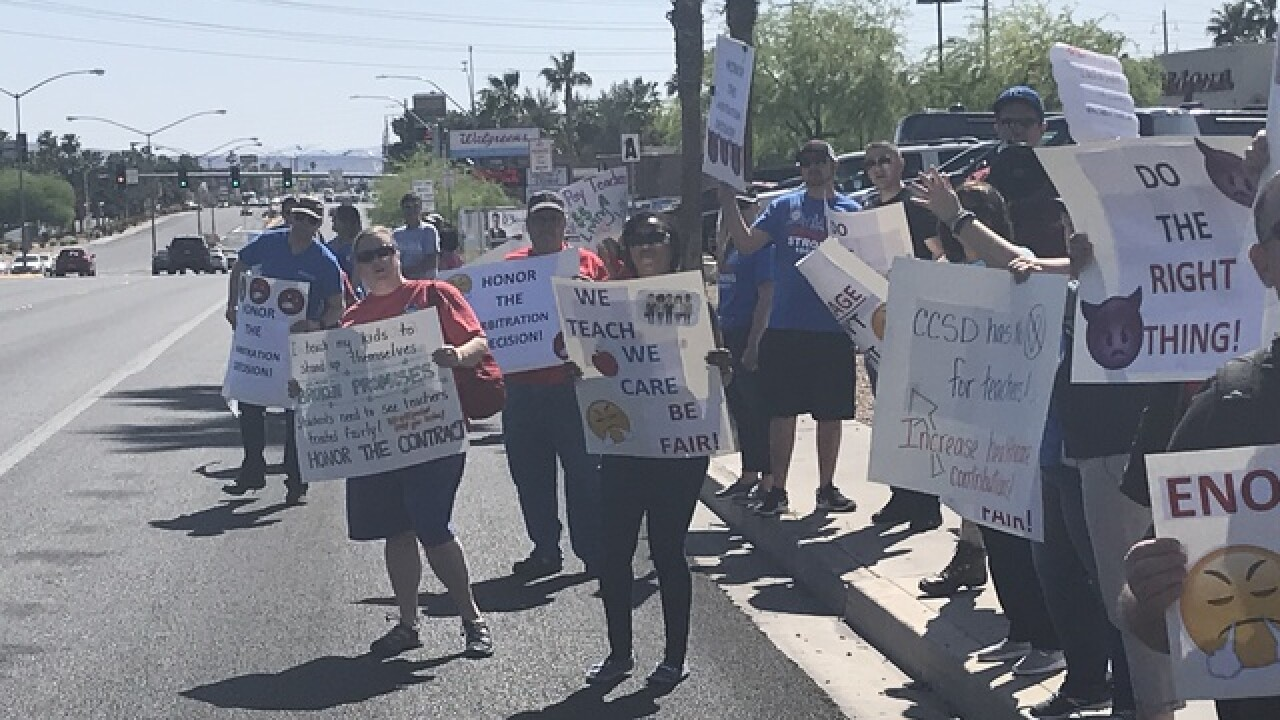 Teachers rally for better pay at CCSD meeting