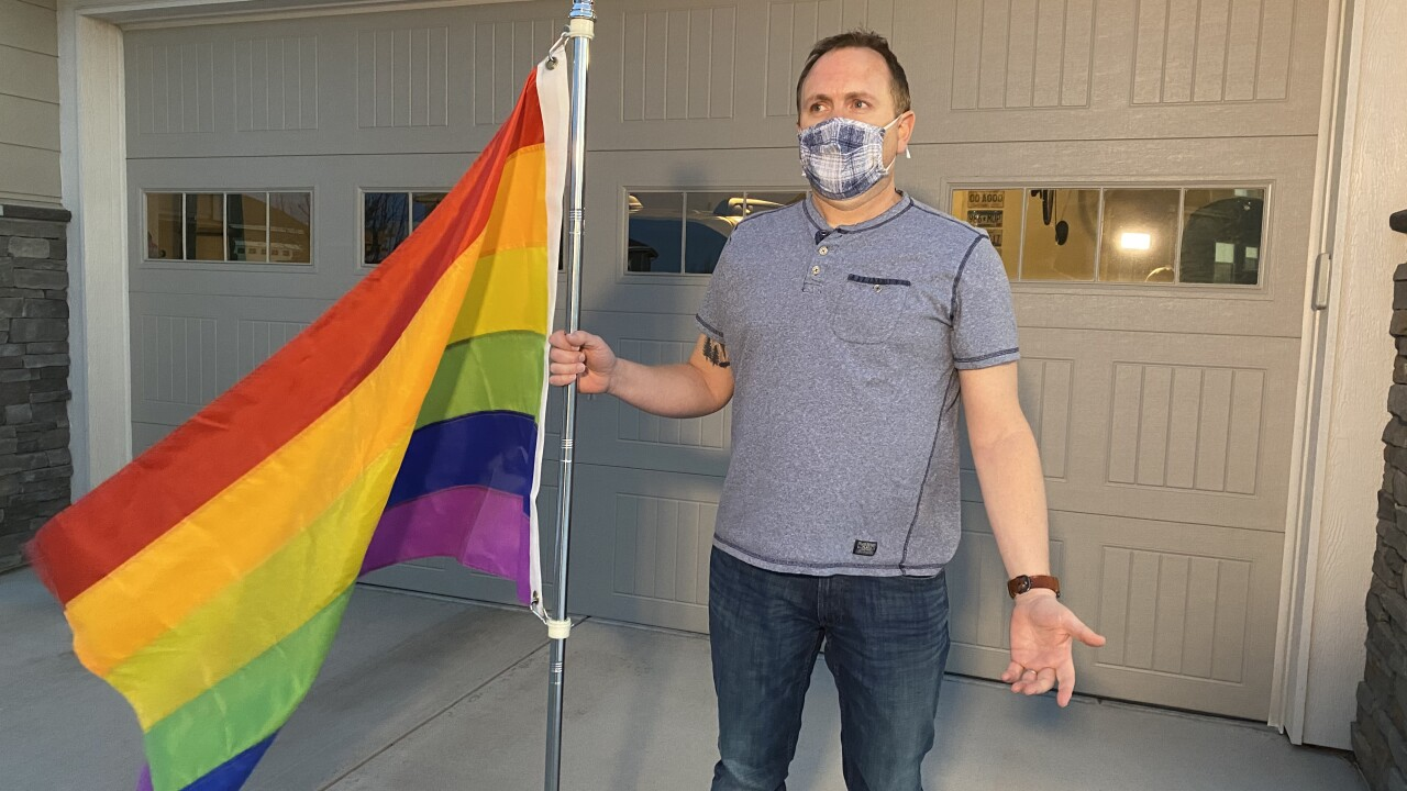 Arapahoe County man with his pride flag he was told to take down