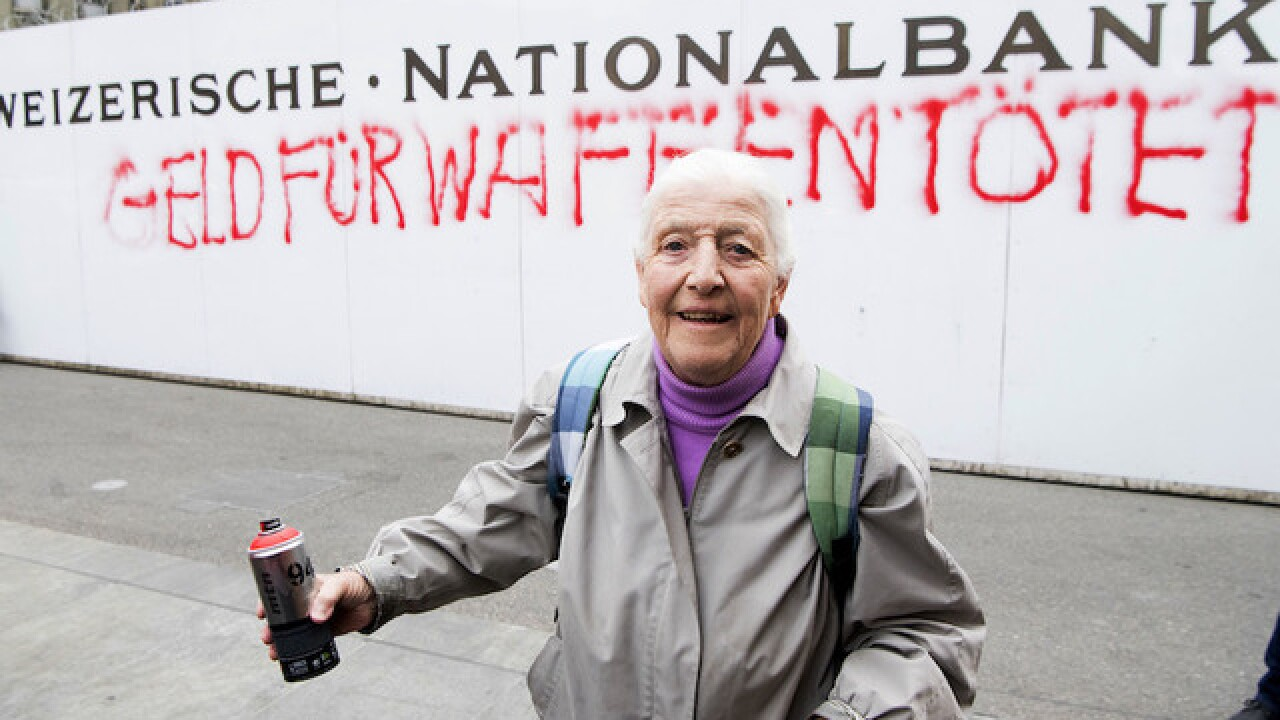 Police arrest 86-year-old graffiti artist for message on Swiss national bank