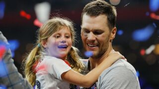 Tom Brady is being dad-shamed after diving off a cliff with his 6-year-old daughter
