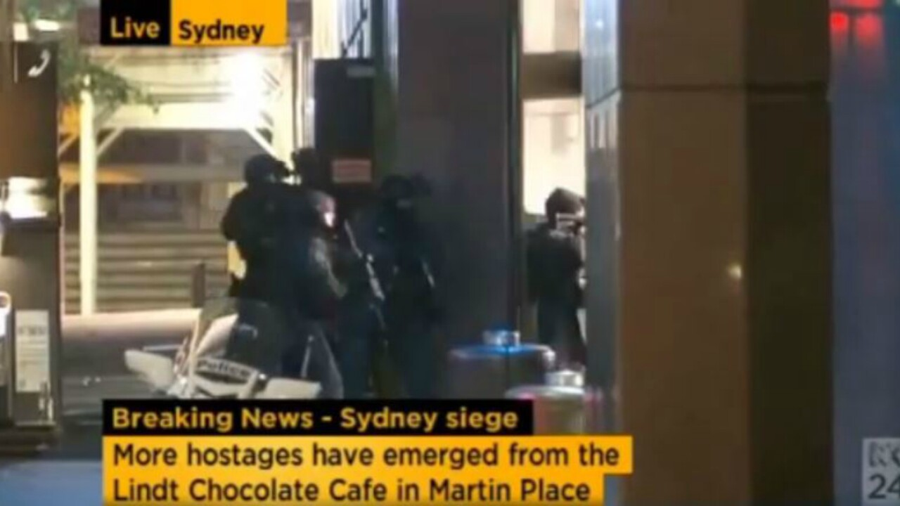 Video captures moment police storm Sydney cafe with hostages