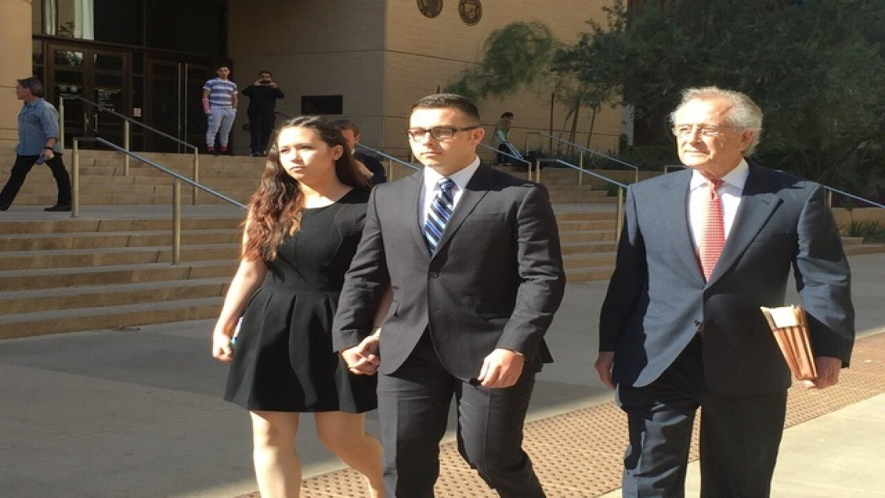 Mesa officer facing murder charge fired