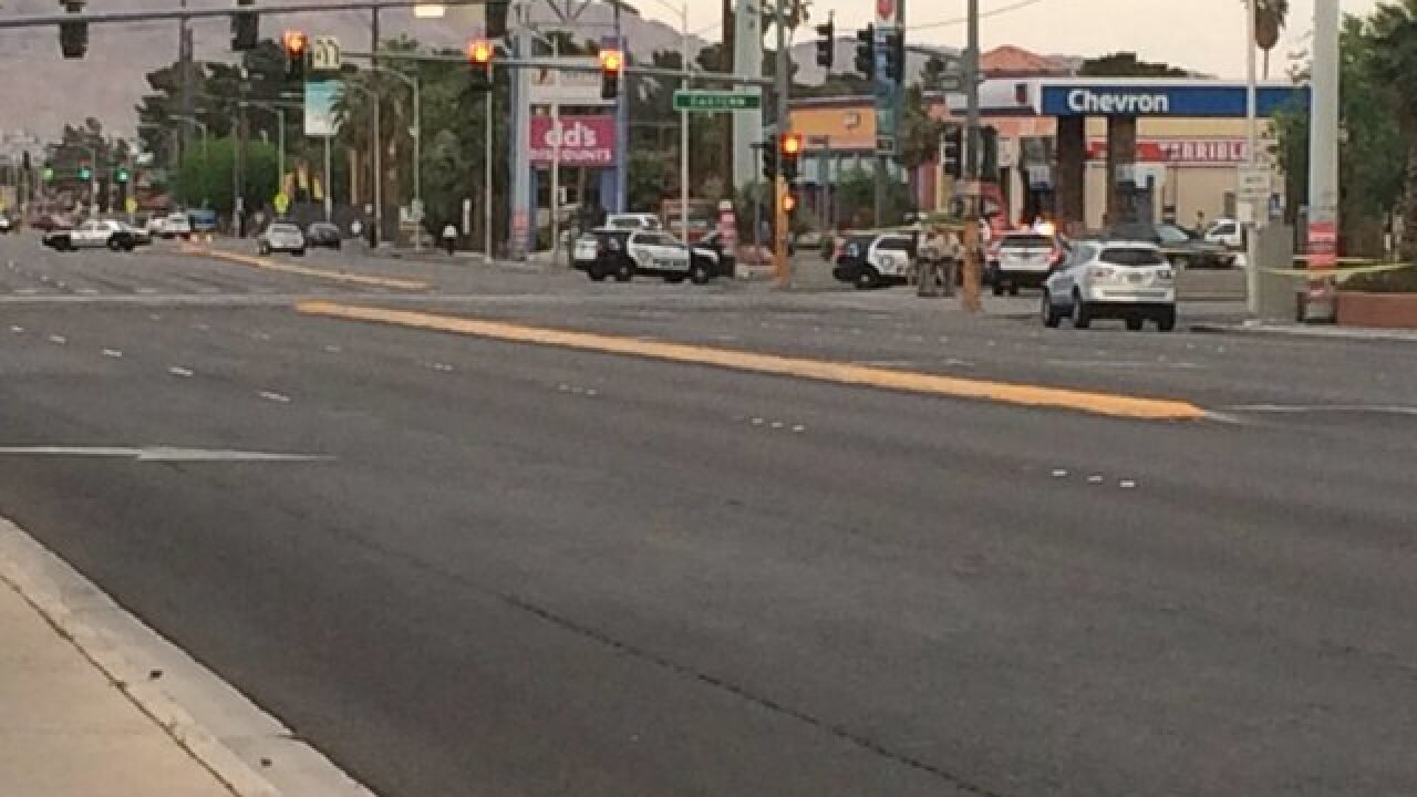 Las Vegas police car hit in downtown chase