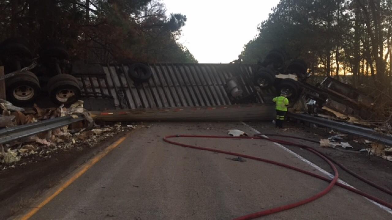 Chicken-hauling truck overturns on 295ramp