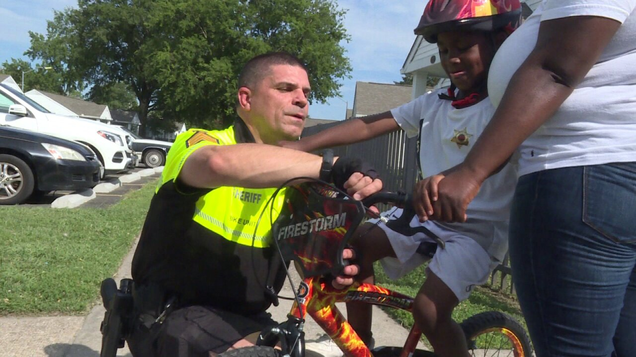 Portsmouth Sheriff's Office Sgt. gives young boy a bike after his was stolen