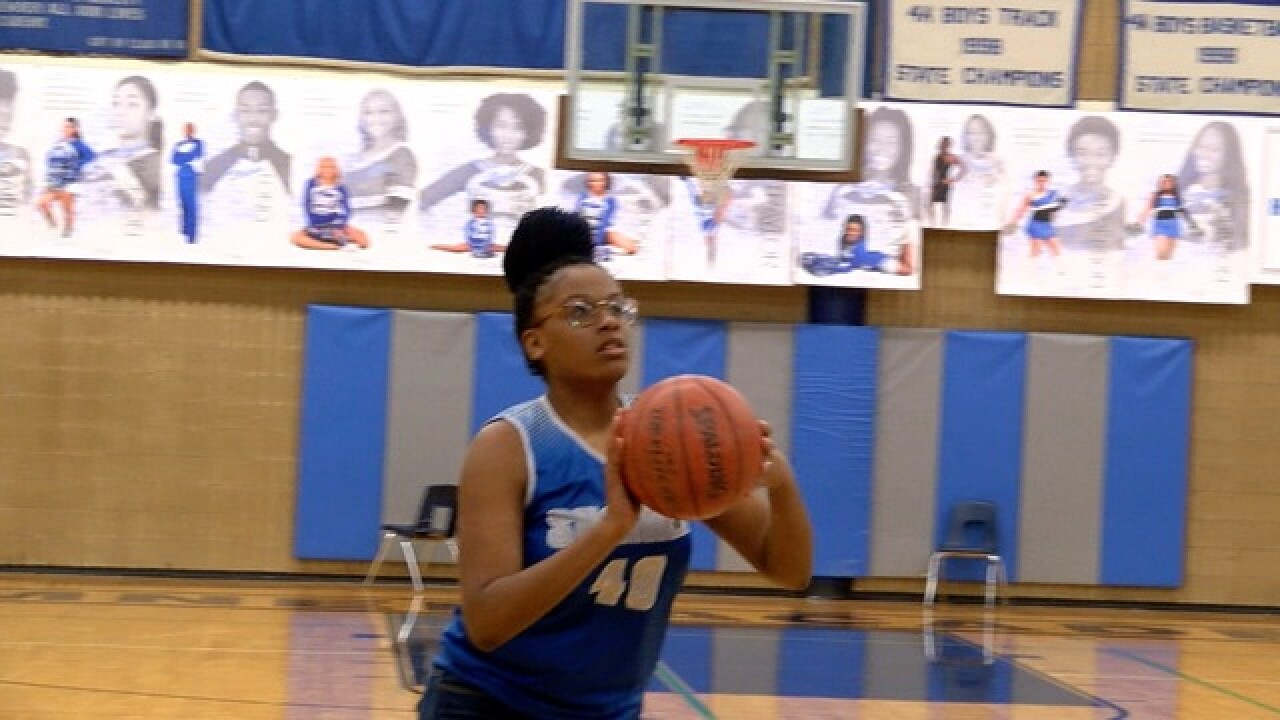 Sumner's Shenice Canady clogs the paint