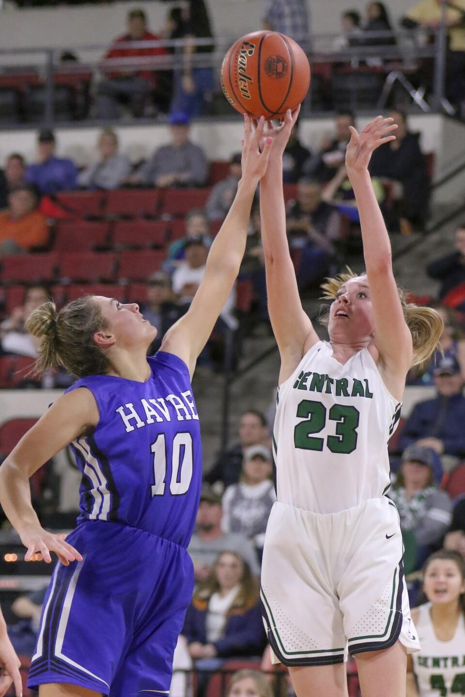 Kyndall Keller gets a piece of the ball as Isabelle Erickson shoots.jpg