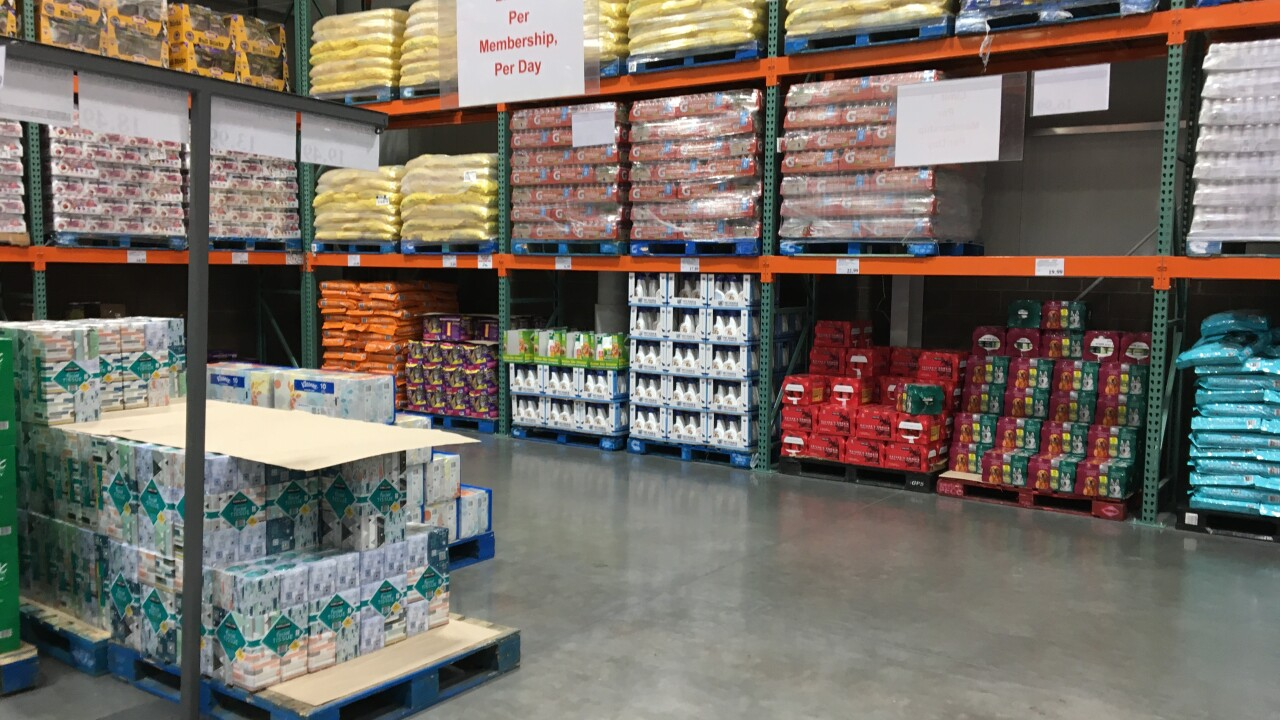 These photos show empty pallets and shelves for items that were items such as toilet paper, paper towels and soda as seen on Nov. 1, 2020 at a Costco location in Henderson, NV