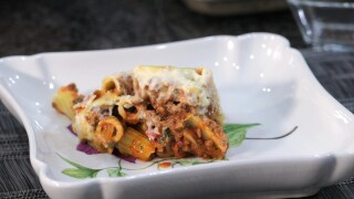 The finished and plated Greek Pastitsio with meat sauce and Béchamel crust.