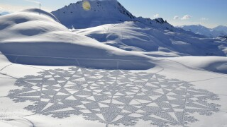 Artist uses snow as canvas for massive geometricaldesigns
