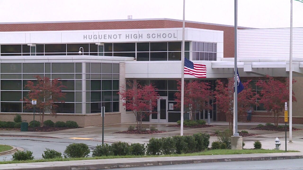 Woman arrested for flashing gun during Richmond school dance competitionfight
