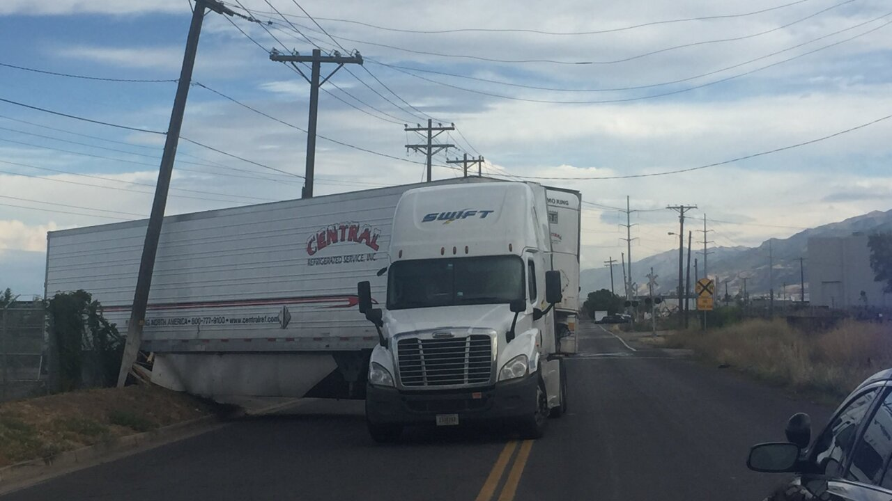 Semi crash, downed power lines closing roads in North Salt Lake