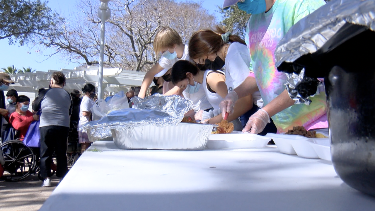 Volunteers with Tacos Not Bombs prepare free meals for the community
