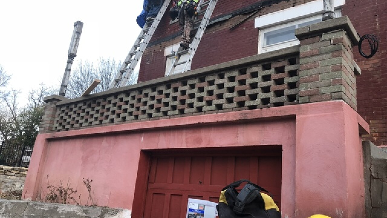 Homeowner getting help fixing crumbling roof