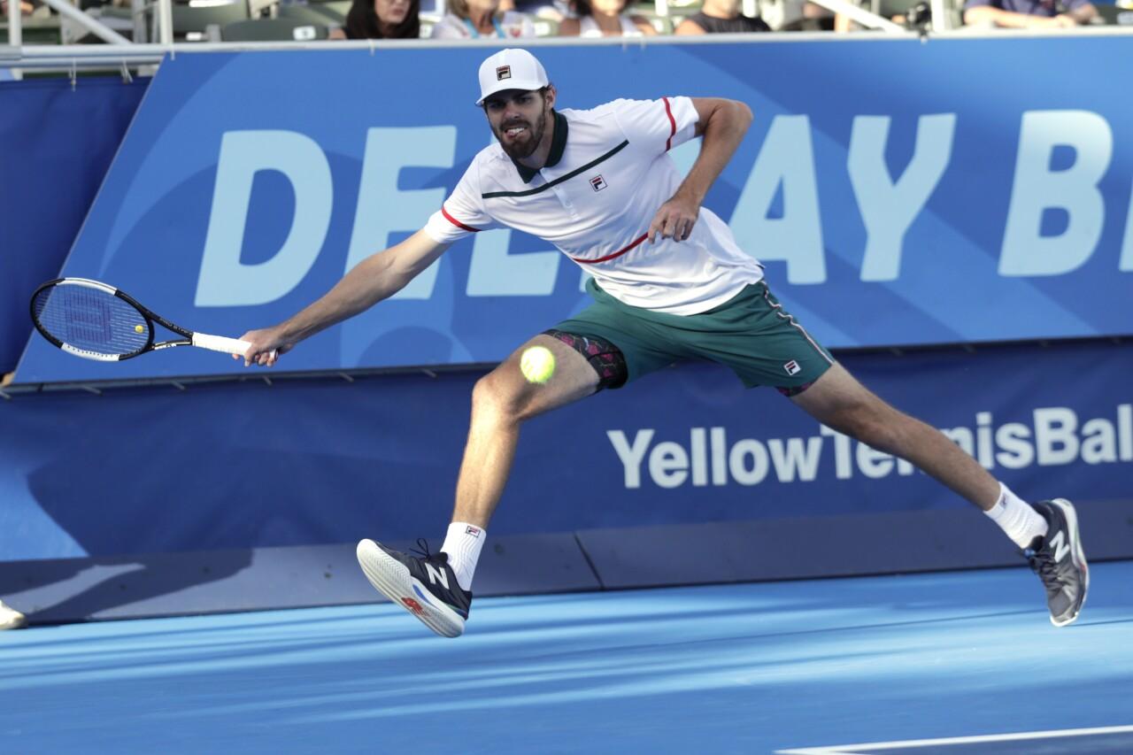 Reilly Opelka returns serve in 2020 Delray Beach Open