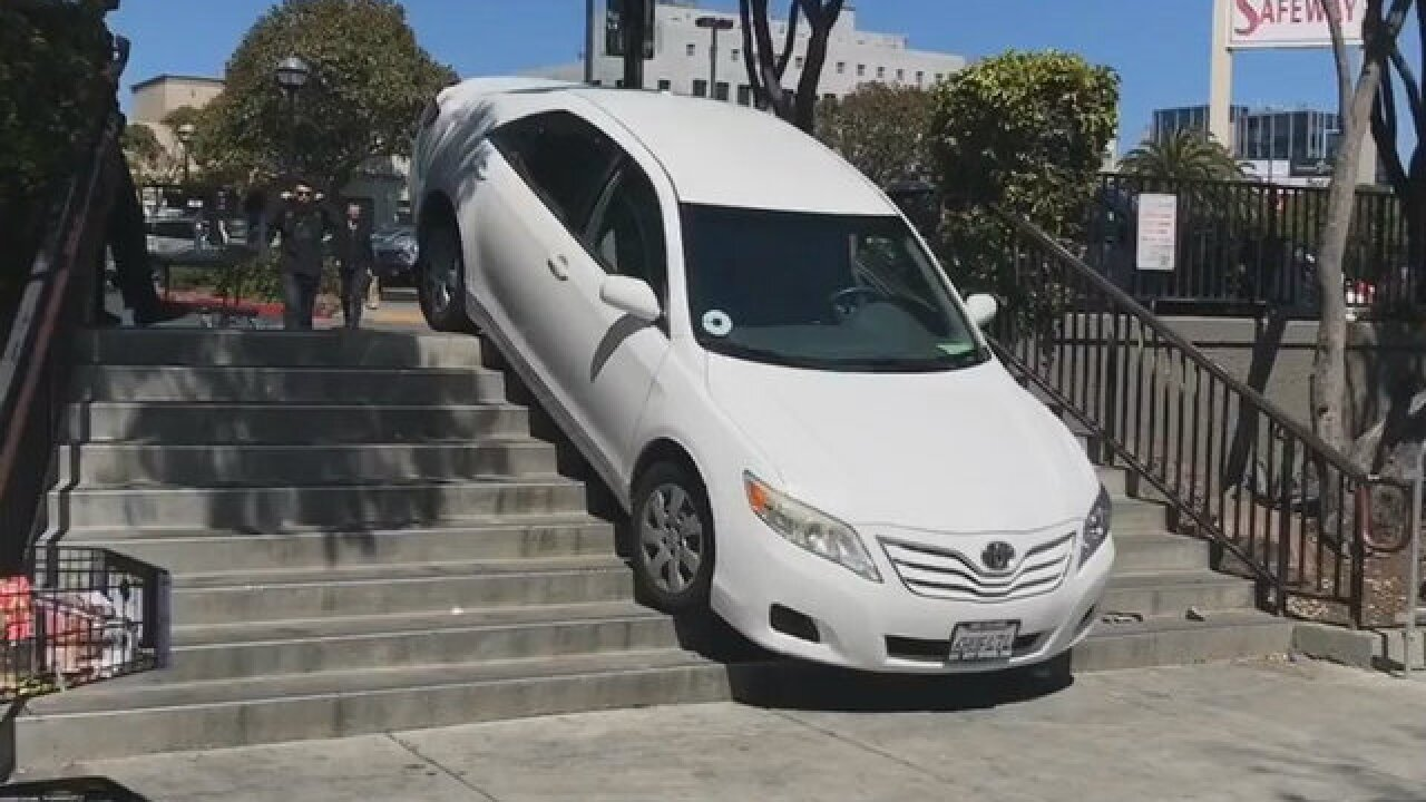 Uber car takes wrong turn, gets stuck on stairs