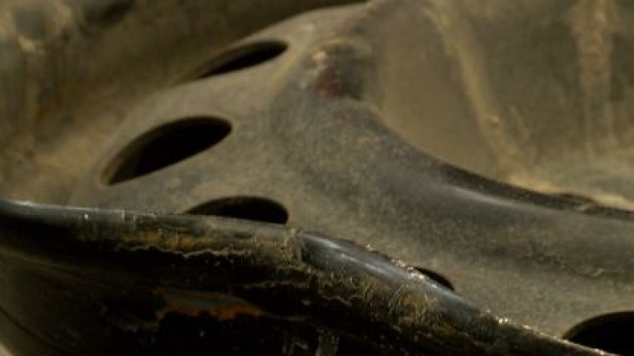pothole damage to rim of wheel car