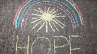 """Chalk art painted with the word """"hope"""""""