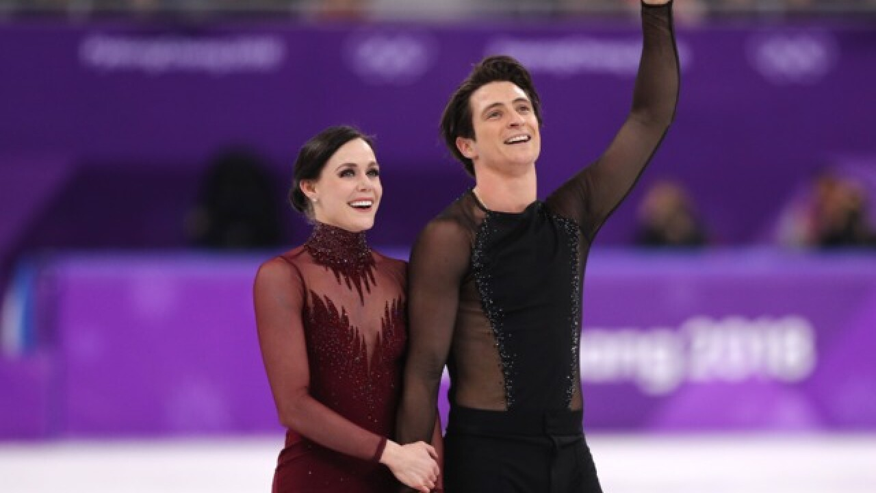 Canadians Virtue and Moir take gold in ice dance