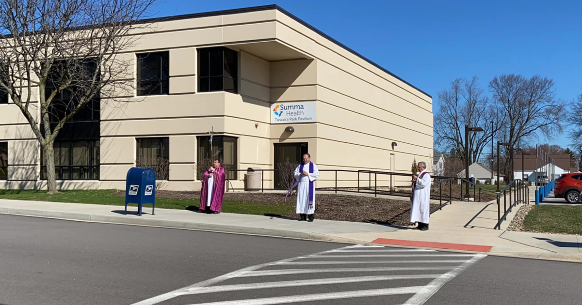 Priests Recite Prayer Outside Hospital