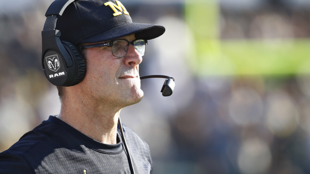 Michigan hires Moore as part of Harbaugh's reshaped staff