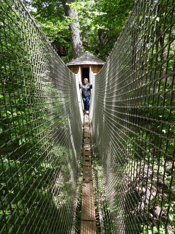 Lisa crosses one of the suspension bridges at Treetop Village..JPG