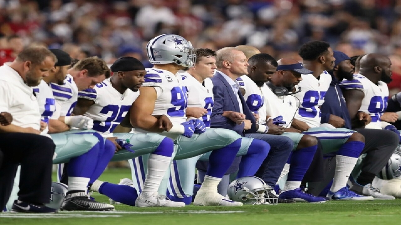 Dallas Cowboys owner Jerry Jones kneels with team before national anthem on Monday Night Football