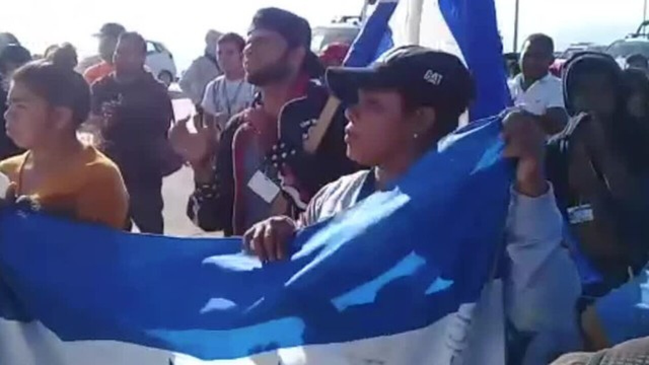 Migrants demand entry or $50,000 during march to US Consulate in Tijuana