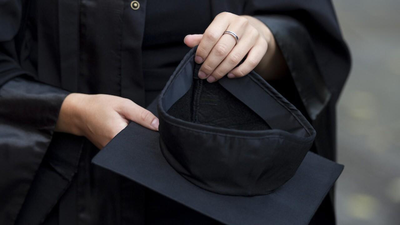 University sorry for saying women should wear low-cut tops to graduation