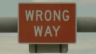 Wrong-way driving sign