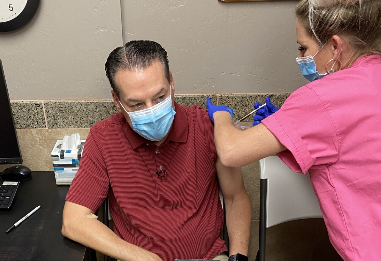 KGUN9 Anchor Pat Parris receives his second injection as part of a COVID-19 vaccine clinical trial in Tucson