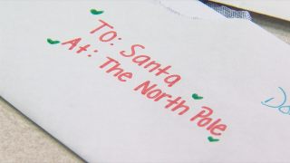 Mail carrier helps Santa respond to letters