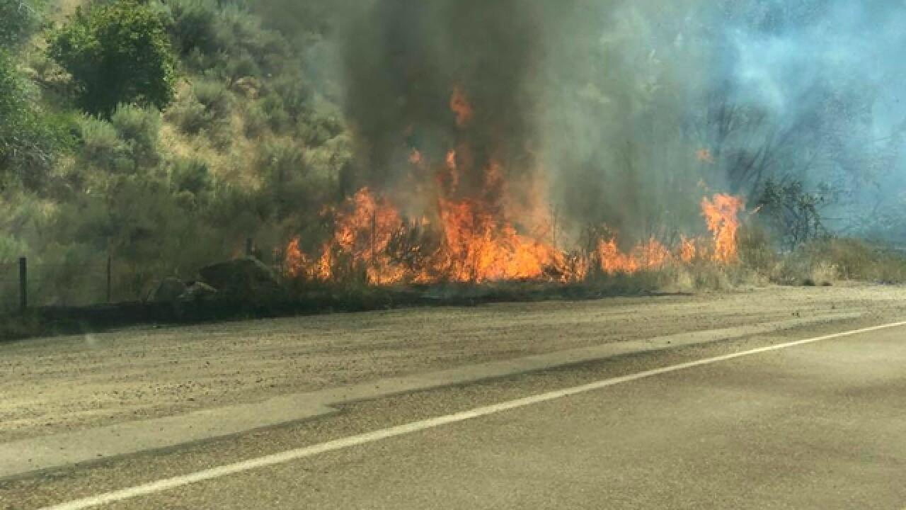 Highway 55 shut down; crews battling wildfire