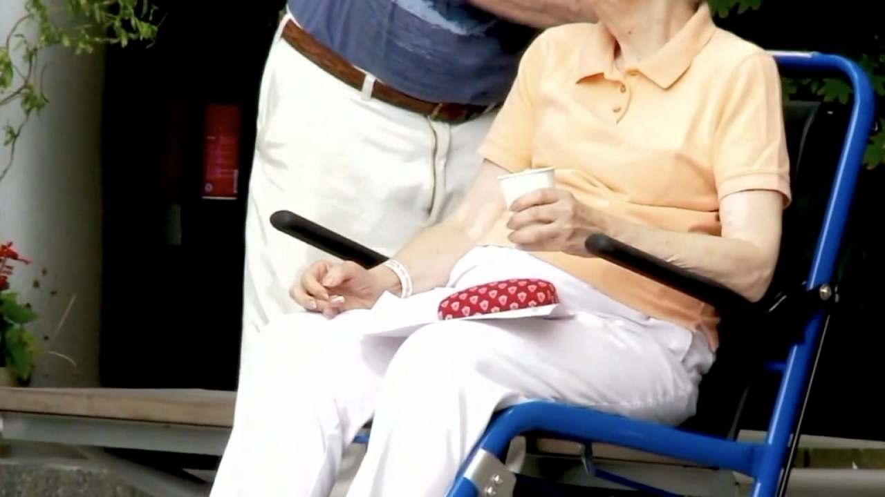 An elderly woman in wheelchair