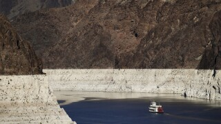 A key reservoir on the Colorado River is shrinking to record low levels, prompting concerns throughout the drought-stricken U.S. West about future water supply. AP photo.